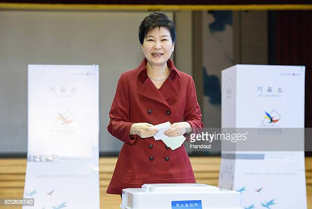 In this handout photo released by the South Korean Presidential Blue House South Korean President Park GeunHye casts her vote in a polling station on...