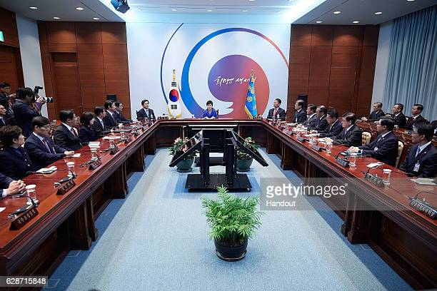 In this handout photo released by the South Korean Presidential Blue House South Korea's President Park GeunHye attends the emergency cabinet meeting...