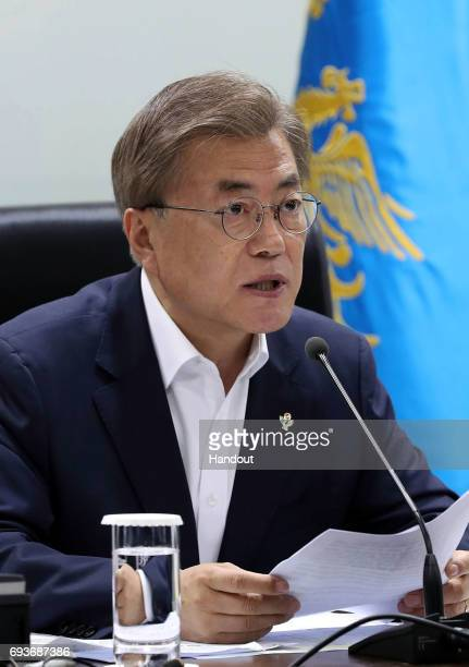 In this handout photo released by the South Korean Presidential Blue House South Korean President Moon Jaein speaks as he presides over a meeting of...