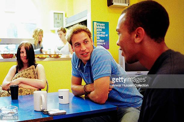 In this handout photo released on September 13 2005 Prince William speaks to young people during a volunteering visit to homelessness charity...
