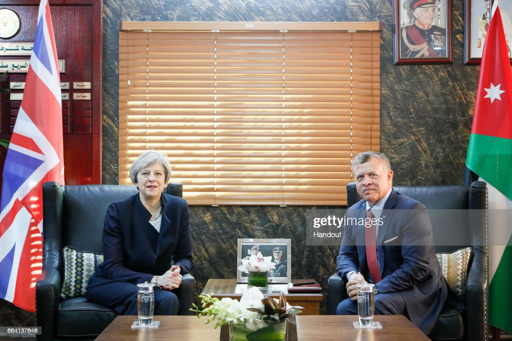 In this handout photo supplied by the Jordanian Royal Palace, King Abdullah II of Jordan (R) meets with British Prime Minster Theresa May (L) on April 3, 2017 in Amman, Jordan. The British Prime Ministers in Jordan discussing issues including terrorism and trade following the triggering of Article 50.