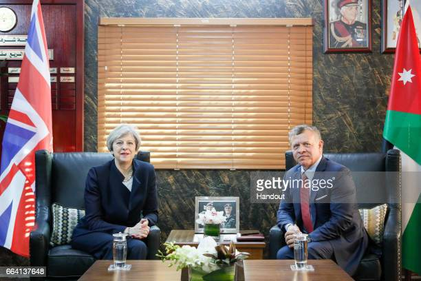 In this handout photo supplied by the Jordanian Royal Palace King Abdullah II of Jordan meets with British Prime Minster Theresa May on April 3 2017...
