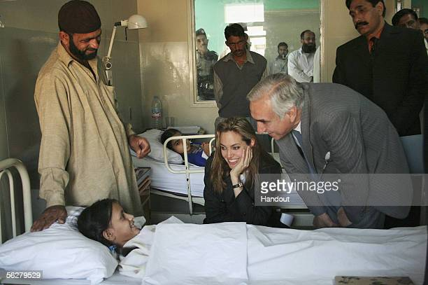 In this handout photo supplied by the United Nations High Commission for Refugees UNHCR Goodwill Ambassador Angelina Jolie visits a young patient in...