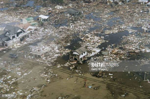 In this handout photo taken from a print via the Indonesian Air Force the scene of devastation in Meulaboh the town closest to the Sunday's...