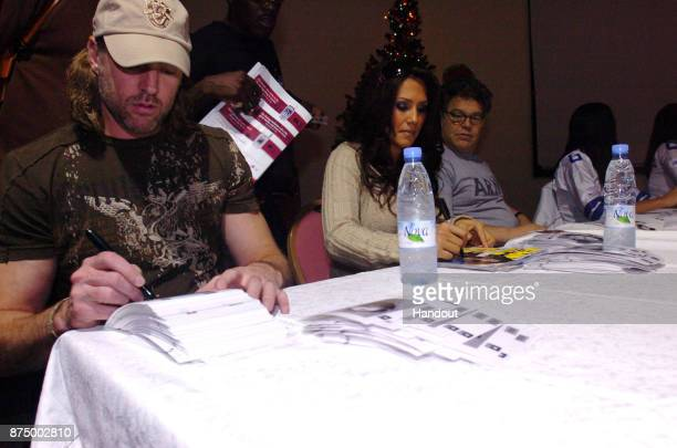 In this handout photofrom 2006 provided by the US Army Country music star Darryl Worley sportscaster Leeann Tweeden and comedian Al Franken meet and...