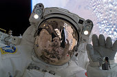 In this handout photograph from NASA Japanese Aerospace Exploration Agency astronaut Soichi Noguchi waves August 1 2005 at a crewmate during...