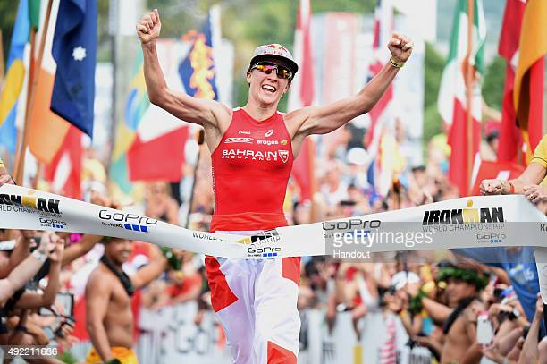 In this handout photograph provided by Ironman Daniela Ryf of Switzerland celebrates winning the 2015 IRONMAN World Championship presented by GoPro...