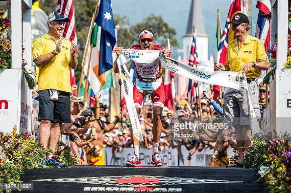 In this handout photograph provided by Ironman Jan Frodeno of Germany celebrates winning the 2015 IRONMAN World Championship presented by GoPro on...