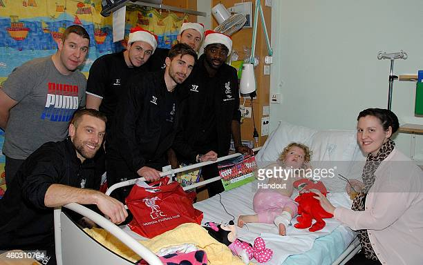 In this handout photograph provided by Liverpool FC Kolo Toure Simon Mignolet Danny Ward Rickie Lambert and Fabio Borini of Liverpool FC visit Alder...