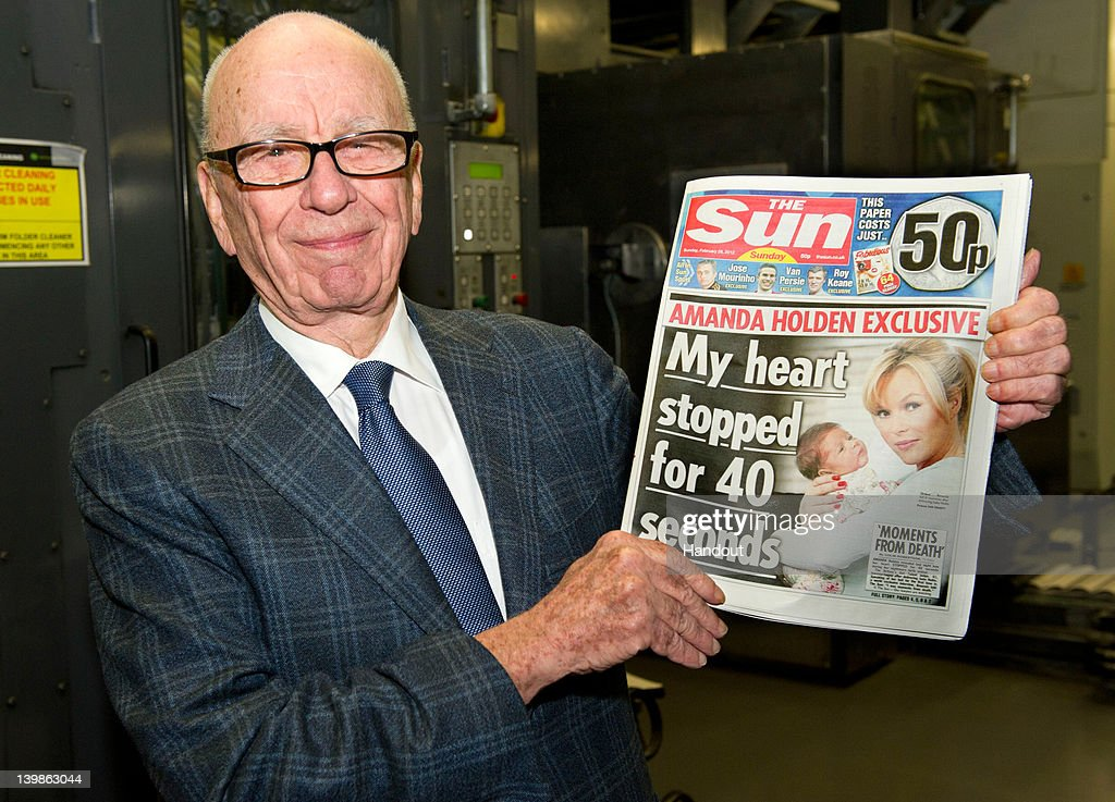 In this handout photograph provided by News International, <a gi-track='captionPersonalityLinkClicked' href=/galleries/search?phrase=Rupert+Murdoch&family=editorial&specificpeople=160571 ng-click='$event.stopPropagation()'>Rupert Murdoch</a>, Chairman and CEO of News Corporation, reviews the first edition of The Sun On Sunday as it comes off the presses on February 25, 2012 in Broxbourne, England. Around 3 million copies of 'The Sun On Sunday', the first ever Sunday edition of News International's daily tabloid newspaper 'The Sun', are due to go on sale on Sunday February 26, 2012.