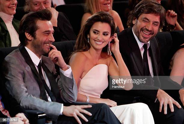 In this handout photograph provided by Spanish Film Academy Spanish actor Javier Bardem and his girlfriend Spanish actress Penelope Cruz attend the...