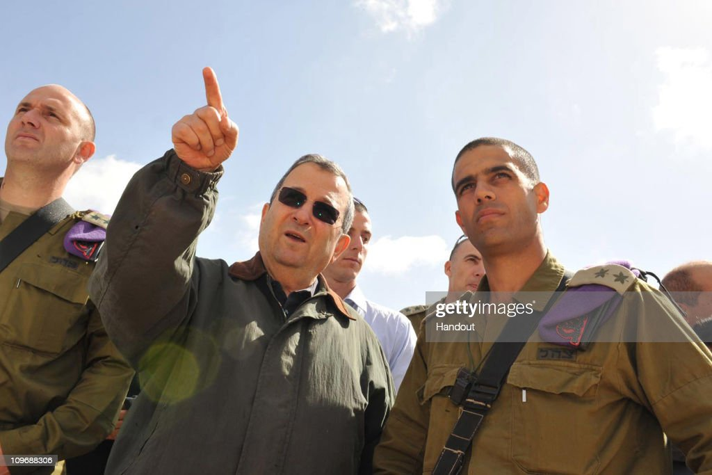 In this handout photograph provided by the Israeli Defense Ministry Defense Minister Ehud Barak is seen on his visit to the Givati Brigade's training...
