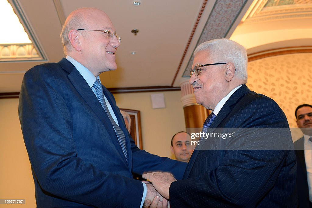 In this handout photograph provided by the Palestinian Press Office (PPO), Palestinian President Mahmoud Abbas shakes hands with the Prime Minister of Lebanon <a gi-track='captionPersonalityLinkClicked' href=/galleries/search?phrase=Najib+Mikati&family=editorial&specificpeople=2466031 ng-click='$event.stopPropagation()'>Najib Mikati</a> during a meeting on January 20, 2013 in Riyadh, Saudi Arabia.
