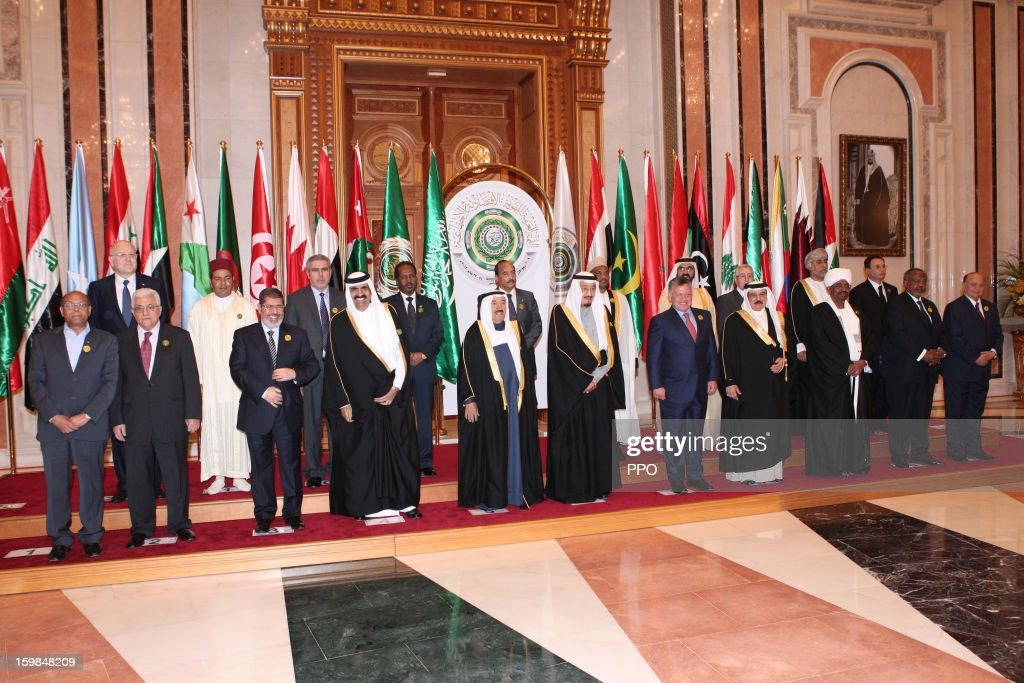 In this handout photograph provided by the Palestinian Press Office (PPO), Palestinian President Mahmoud Abbas poses with Arab heads of state and government during the Third Arab Economic, Social and Developmental Summit on January 21, 2013 in Riyadh, Saudi Arabia. Riyadhi is hosting the two-day summit aimed at improving trade, development and economic cooperation in Arab countries.