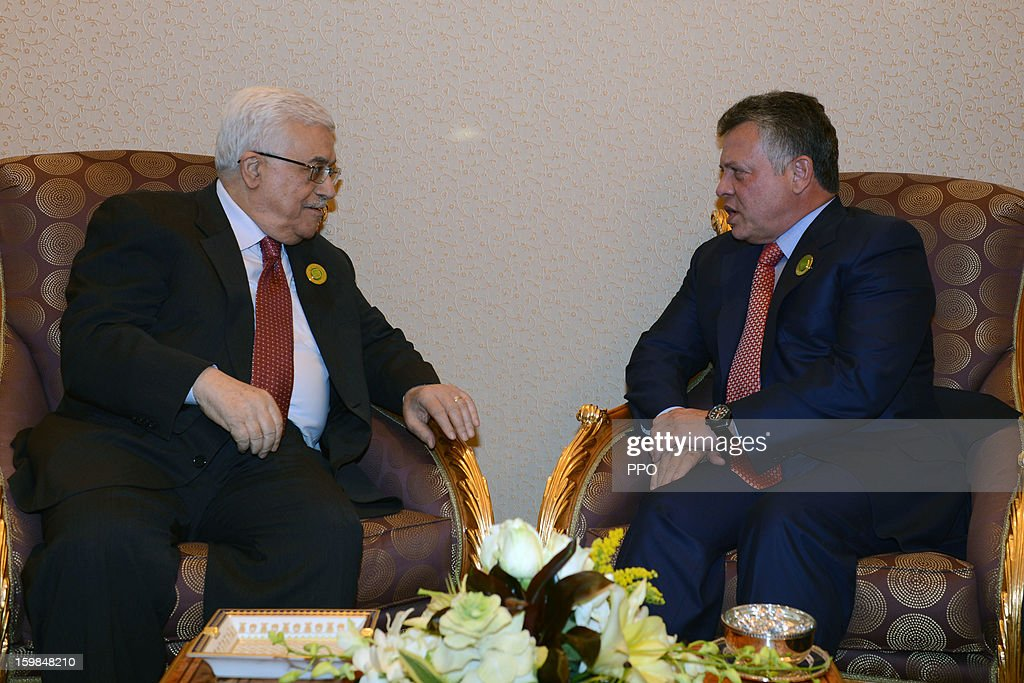 In this handout photograph provided by the Palestinian Press Office (PPO), Palestinian President Mahmoud Abbas meets with King Abdullah II of Jordon on January 21, 2013 in Riyadh, Saudi Arabia. Abbas is in Saudia Arabia to attend the Third Arab Economic, Social and Developmental Summit.