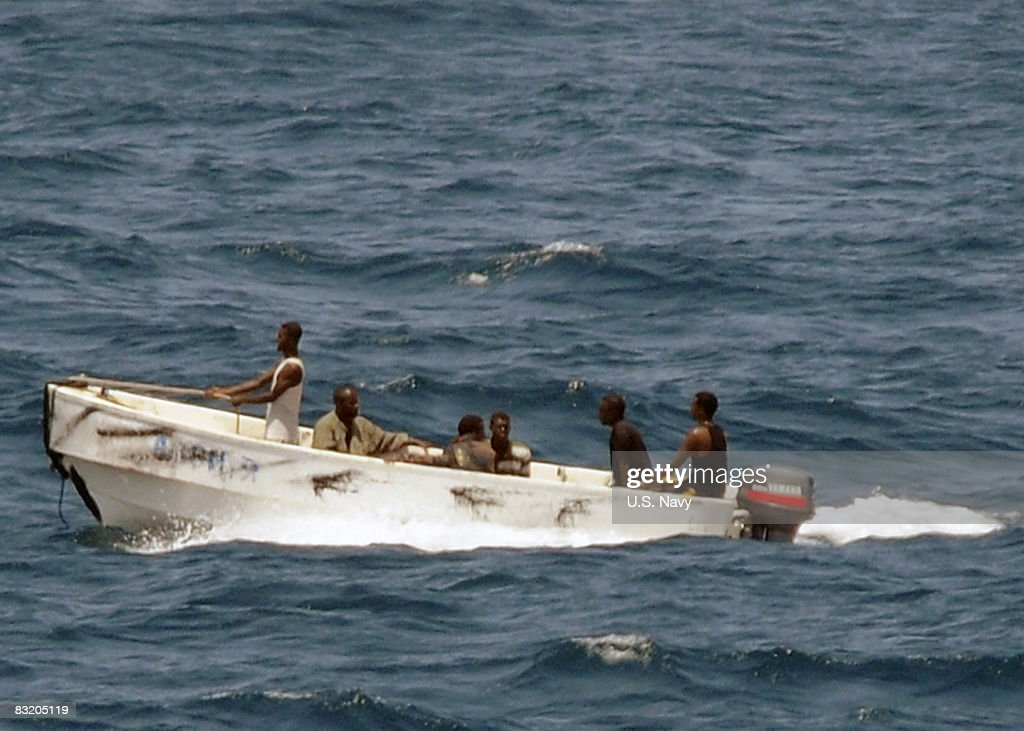 In this handout photograph provided by the US Navy pirates leave the merchant vessel MV Faina for the Somalia shore under observation by a US Navy...