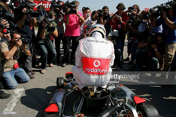 In this handout photograph provided by Vodafone Fernando Alonso sits in his kart during the Vodafone GoKarting Challenge prior to the Spanish Grand...