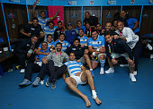 In this handout photograph provided by World Rugby Diego Maradona poses with the Argentina team in the dressing room after the 2015 Rugby World Cup...