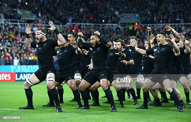 In this handout photograph provided by World Rugby New Zealand All Blacks perform the Haka ahead of the 2015 Rugby World Cup Pool C match between New...