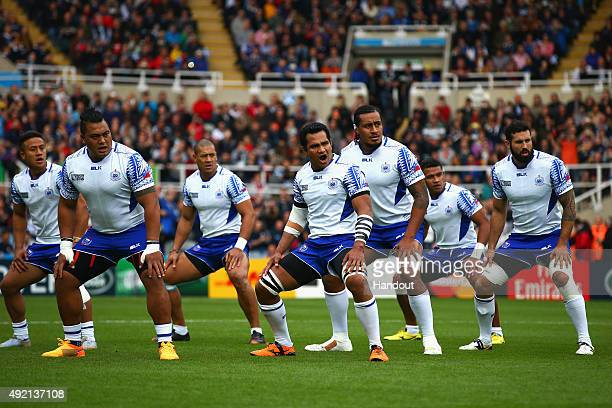 In this handout photograph provided by World Rugby The Samoan team perform the Siva Tau prior to the 2015 Rugby World Cup Pool B match between Samoa...