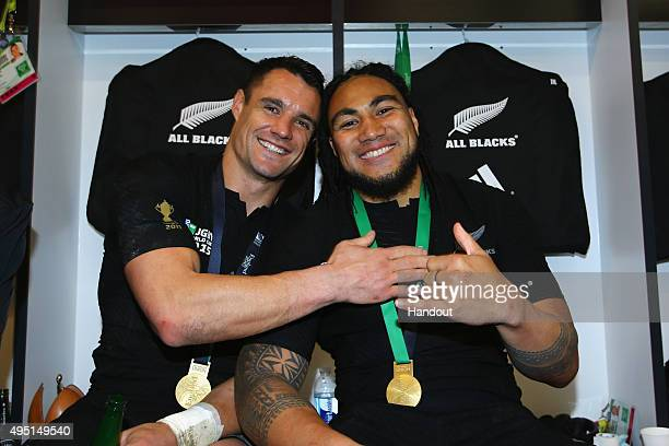 In this handout photograph provided by World Rugby Dan Carter and Ma'a Nonu of the New Zealand All Blacks pose in the dressing room following the...