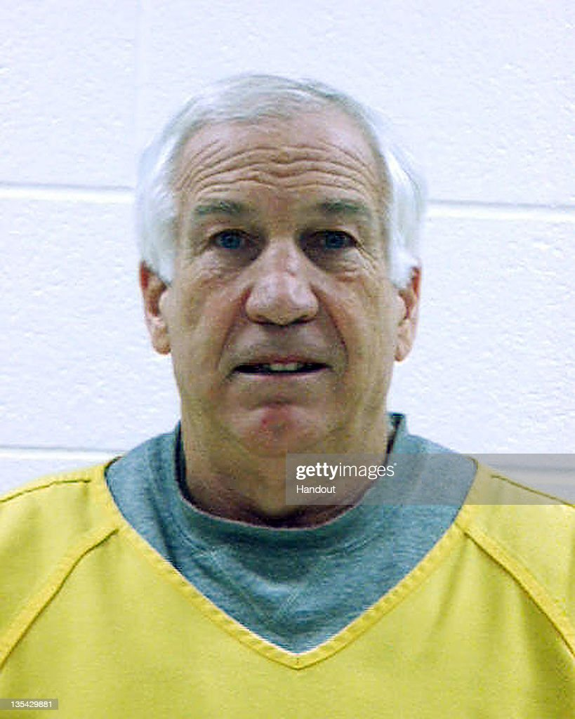 In this handout photograph supplied by the Centre County Correctional Facility, Gerald 'Jerry' Sandusky, 67, poses for his mugshot after being arrested on December 7, 2011 in Bellefonte, Pennsylvania. New criminal charges were brought by two new accusers and taken to the Centre County Correctional Facility after failing to post $250,000 bail.