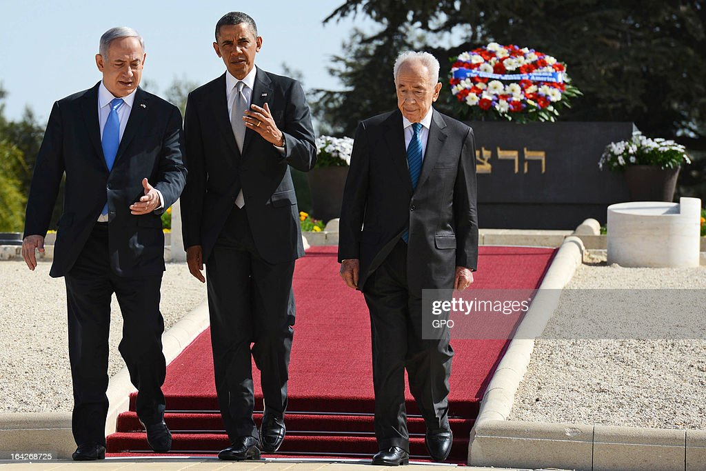 In this handout photograph supplied by the Government Press Office of Israel (GPO), U.S. President Barack Obama walks away from the grave of Theodore Herzl next to Israel's Prime Minister Benjamin Netanyahu and President Shimon Peres after Marines layed a wreath on behalf of the U.S. President during a visit to Mount Herzl on March 22, 2013 in Jerusalem, Israel. This is Obama's first visit as president to the region and his itinerary includes meetings with the Palestinian and Israeli leaders as well as a visit to the Church of the Nativity in Bethlehem.