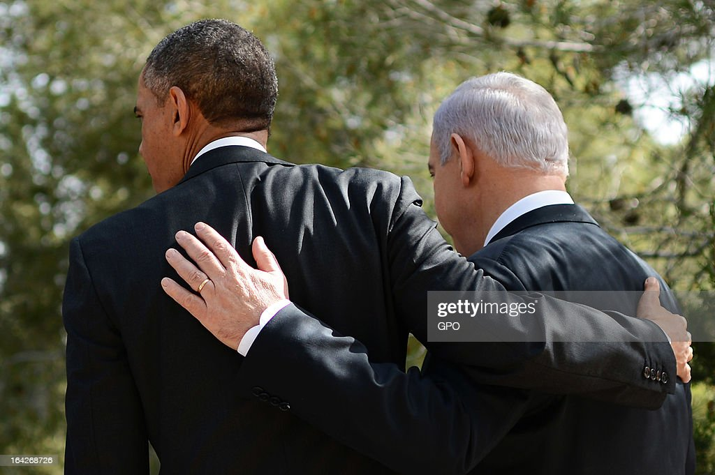 In this handout photograph supplied by the Government Press Office of Israel (GPO), U.S. President Barack Obama and Israel's Prime Minister Benjamin Netanyahu place their arms around each other during a visit to Mount Herzl on March 22, 2013 in Jerusalem, Israel. This is Obama's first visit as president to the region and his itinerary includes meetings with the Palestinian and Israeli leaders as well as a visit to the Church of the Nativity in Bethlehem.