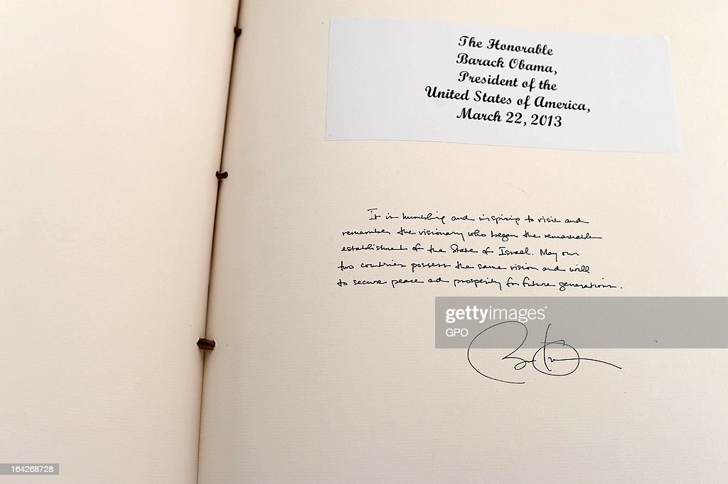 In this handout photograph supplied by the Government Press Office of Israel (GPO), A message written by U.S. President Barack Obama is displayed in the Mount Herzl visitor book during his visit to Mount Herzl on March 22, 2013 in Jerusalem, Israel. This is Obama's first visit as president to the region and his itinerary includes meetings with the Palestinian and Israeli leaders as well as a visit to the Church of the Nativity in Bethlehem.