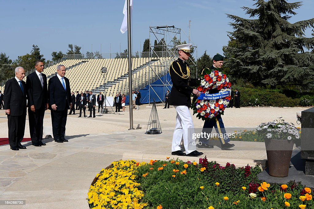 In this handout photograph supplied by the Government Press Office of Israel (GPO), Marines lay a wreath at the grave of Theodore Herzl on behalf of U.S. President Barack Obama as he pays his respects next to Israel's Prime Minister Benjamin Netanyahu and President Shimon Peres during a visit to Mount Herzl on March 22, 2013 in Jerusalem, Israel. This is Obama's first visit as president to the region and his itinerary includes meetings with the Palestinian and Israeli leaders as well as a visit to the Church of the Nativity in Bethlehem.