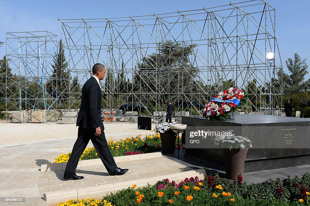 In this handout photograph supplied by the Government Press Office of Israel (GPO), U.S. President Barack Obama pays his respects at the grave of Theodore Herzl after Marines layed a wreath on his behalf during a visit to Mount Herzl on March 22, 2013 in Jerusalem, Israel. This is Obama's first visit as president to the region and his itinerary includes meetings with the Palestinian and Israeli leaders as well as a visit to the Church of the Nativity in Bethlehem.