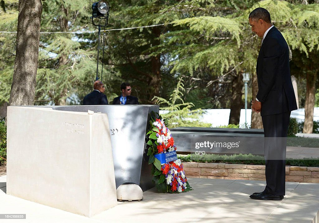 In this handout photograph supplied by the Government Press Office of Israel (GPO), U.S. President Barack Obama pays his repsects at the grave of former Israeli Prime Minister Yitzhak Rabin after laying a wreath during a visit to Mount Herzl on March 22, 2013 in Jerusalem, Israel. This is Obama's first visit as president to the region and his itinerary includes meetings with the Palestinian and Israeli leaders as well as a visit to the Church of the Nativity in Bethlehem.