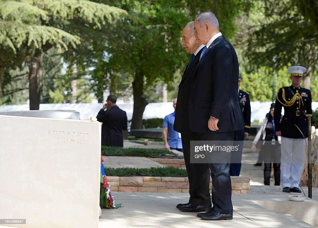 In this handout photograph supplied by the Government Press Office of Israel (GPO), Israel's Prime Minister Benjamin Netanyahu and President Shimon Peres pay their respects at the grave of former Israeli Prime Minster Yitzhak Rabin after U.S. President Barack Obama had layed a wreath during a visit to Mount Herzl on March 22, 2013 in Jerusalem, Israel. This is Obama's first visit as president to the region and his itinerary includes meetings with the Palestinian and Israeli leaders as well as a visit to the Church of the Nativity in Bethlehem.