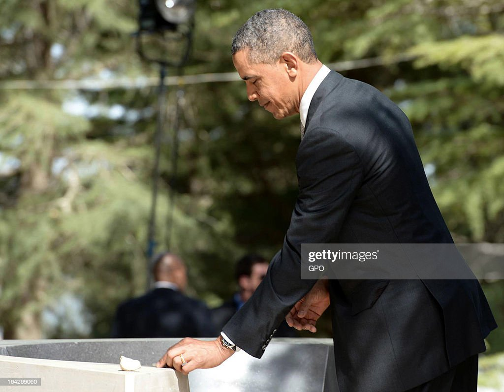 In this handout photograph supplied by the Government Press Office of Israel (GPO), U.S. President Barack Obama places a stone on the grave of Yitzhak and Keah Rabin during a visit to Mount Herzl on March 22, 2013 in Jerusalem, Israel. This is Obama's first visit as president to the region and his itinerary includes meetings with the Palestinian and Israeli leaders as well as a visit to the Church of the Nativity in Bethlehem.