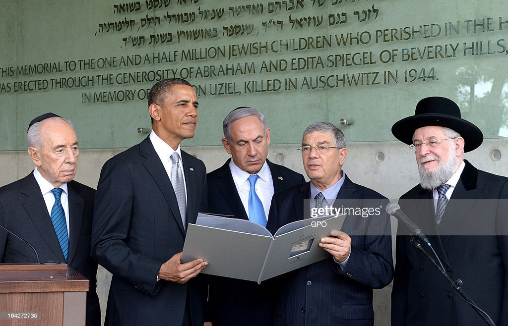 In this handout photograph supplied by the Government Press Office of Israel (GPO), U.S. President Barack Obama visits the children's memorial at the Yad Vashem Holocaust museum with (L-R) Israel's President Shimon Peres, Israel's Prime Minster Benjamin Netanyahu, Chairman of the Yad Vashem Directorate Avner Shalev and Rabbi Yisrael Meir Lau during a visit to Yad Vashem at Mount Herzl on March 22, 2013 in Jerusalem, Israel. This is Obama's first visit as president to the region and his itinerary includes meetings with the Palestinian and Israeli leaders as well as a visit to the Church of the Nativity in Bethlehem.