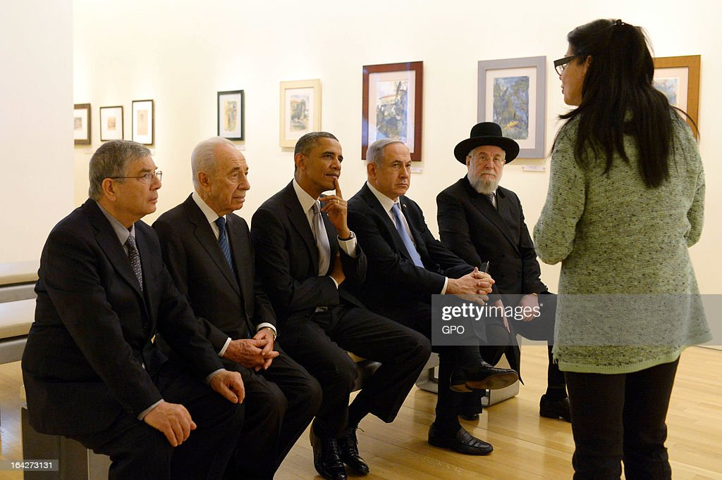 In this handout photograph supplied by the Government Press Office of Israel (GPO), U.S. President Barack Obama listens to a talk during a visit to the Yad Vashem Holocaust Museum with Rabbi Yisrael Meir Lau, Israel's President Shimon Peres, Israel's Prime Minster Benjamin Netanyahu and Chairman of the Yad Vashem Directorate Avner Shalev during a visit to Yad Vashem at Mount Herzl on March 22, 2013 in Jerusalem, Israel. This is Obama's first visit as president to the region and his itinerary includes meetings with the Palestinian and Israeli leaders as well as a visit to the Church of the Nativity in Bethlehem.