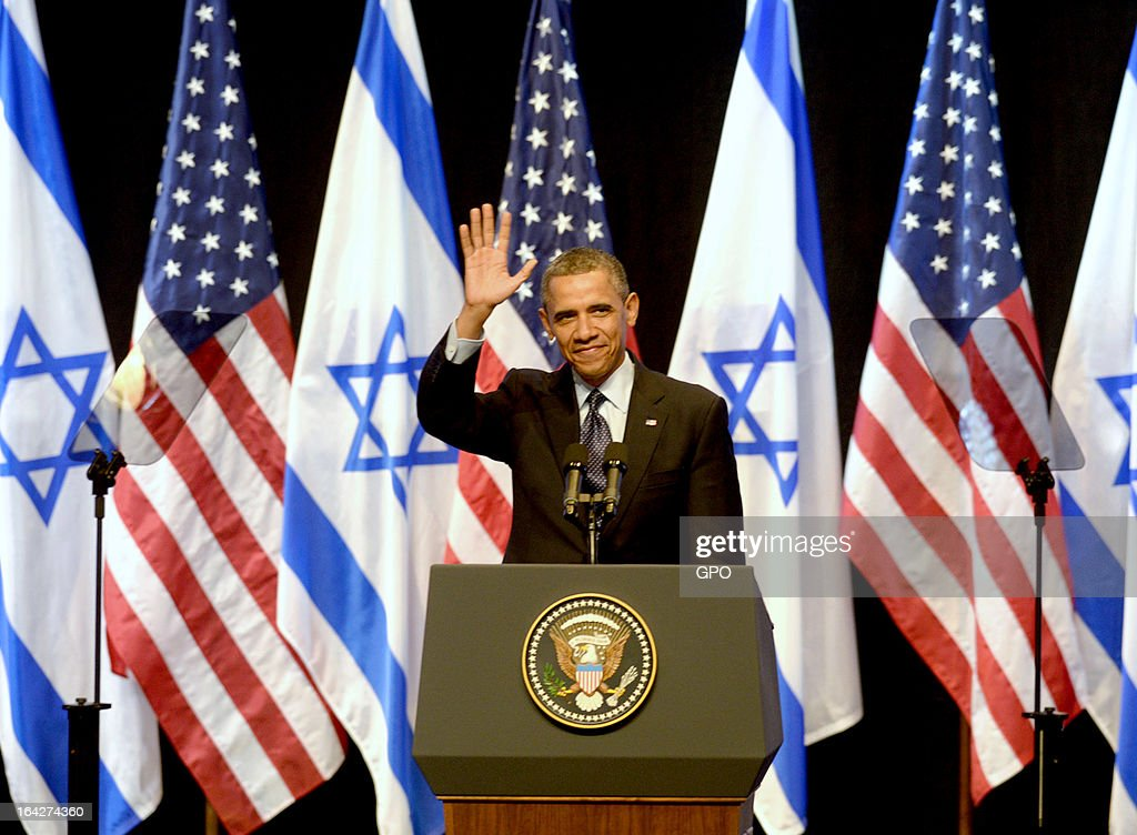 In this handout photograph supplied by the Government Press Office of Israel (GPO), U.S. President Barack Obama waves to the audience after delivering a speech to Israeli students at the International Convention Center on March 21, 2013 in Jerusalem, Israel. This is Obama's first visit as president to the region and his itinerary includes meetings with the Palestinian and Israeli leaders as well as a visit to the Church of the Nativity in Bethlehem.