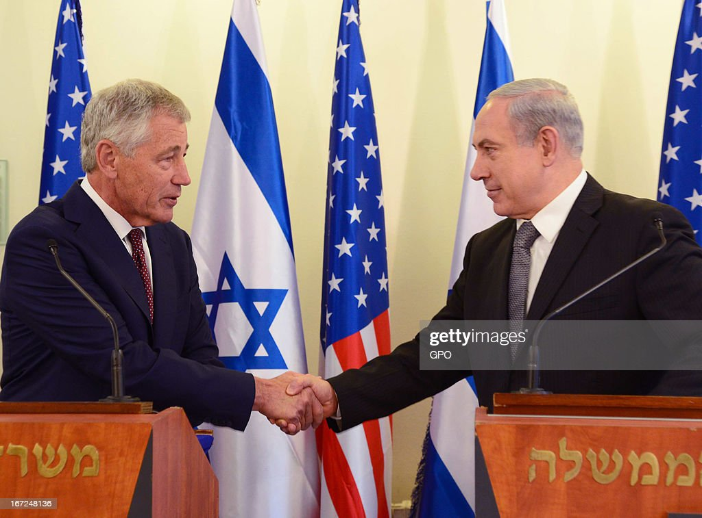 In this handout photograph supplied by the Government Press Office of Israel (GPO), U.S. Defense Secretary Chuck Hagel and Israeli PM Benyamin Netanyahu shake hands during a meeting on April 23, 2013 in Jerusalem, Israel. Hagel arrived in Israel at the start of a six-day regional tour, his first since taking over as Pentagon chief two months ago, which was likely to be dominated by concerns over Iran's nuclear programme and Syria's civil war.