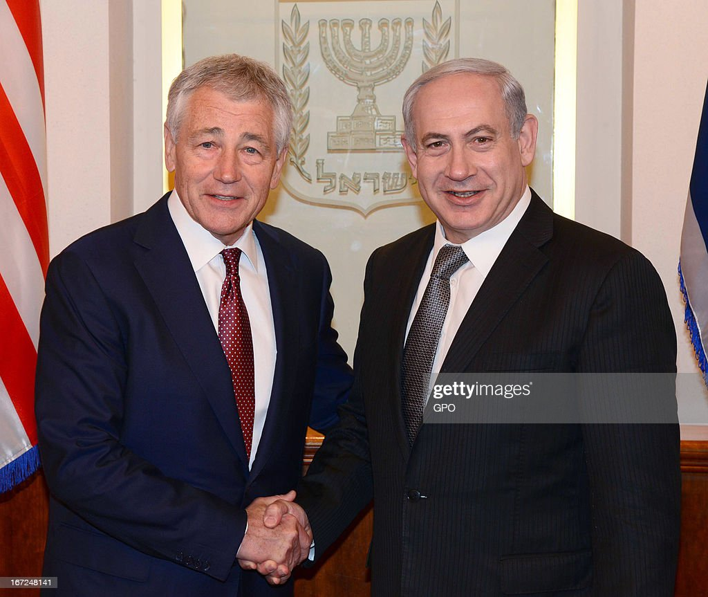 In this handout photograph supplied by the Government Press Office of Israel (GPO), U.S. Defense Secretary <a gi-track='captionPersonalityLinkClicked' href=/galleries/search?phrase=Chuck+Hagel&family=editorial&specificpeople=504963 ng-click='$event.stopPropagation()'>Chuck Hagel</a> and Israeli PM Benyamin Netanyahu shake hands during a meeting on April 23, 2013 in Jerusalem, Israel. Hagel arrived in Israel at the start of a six-day regional tour, his first since taking over as Pentagon chief two months ago, which was likely to be dominated by concerns over Iran's nuclear programme and Syria's civil war.