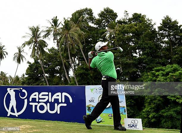In this handout photograph taken and received from the Asian Tour on June 20 2015 SSP Chawrasia of India plays a shot during round two of the Queen's...