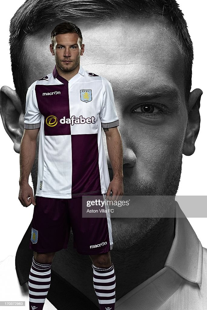 In this handout photographic illustration provided by Aston Villa, Andreas Weimann of Aston Villa wears the new Macron away kit for the 2013-14 season. Aston Villa and Macron are pleased to unveil the club's brand new home and away kits for the 2013-14 season. Both the home and away jerseys will offer players and fans a more slim-fit style from last season, offering maximum comfort. The home shirt retains the traditional look of Villa kits from past eras, closely resembling the shirt worn in the European Cup-winning season of 1981-82. The sleeves and collarbone of the home jersey have mesh inserts that give maximum breathability to the garment. The shirt also has a stylish striped v-neck collar and the reverse is embossed with the club's 'Prepared' motto. The away jersey is a modern design with white and blackcurrant quarters adorning both the front and the rear. This new cross-colour is also incorporated into the design of the collars and cuffs. The shirt retains a vintage collar with v-neck drop, ribbed striped cuffs, side flank micromesh inserts and club's 'Prepared' motto embossed onto the rear.