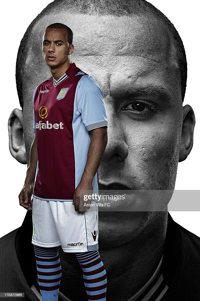 In this handout photographic illustration provided by Aston Villa, Gabriel Agbonlahor of Aston Villa wears the new Macron home kit for the 2013-14 season. Aston Villa and Macron are pleased to unveil the club's brand new home and away kits for the 2013-14 season. Both the home and away jerseys will offer players and fans a more slim-fit style from last season, offering maximum comfort. The home shirt retains the traditional look of Villa kits from past eras, closely resembling the shirt worn in the European Cup-winning season of 1981-82. The sleeves and collarbone of the home jersey have mesh inserts that give maximum breathability to the garment. The shirt also has a stylish striped v-neck collar and the reverse is embossed with the club's 'Prepared' motto. The away jersey is a modern design with white and blackcurrant quarters adorning both the front and the rear. This new cross-colour is also incorporated into the design of the collars and cuffs. The shirt retains a vintage collar with v-neck drop, ribbed striped cuffs, side flank micromesh inserts and club's 'Prepared' motto embossed onto the rear.