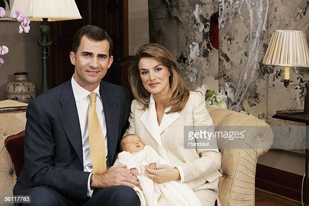 In this handout picture from the Casa Real Prince Felipe of Spain and Princess Letizia hold their newborn daughter Princess Leonor for a photo...