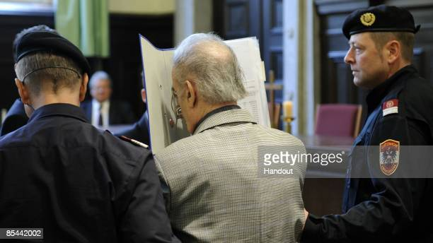 In this handout picture Josef Fritzl covers his face as he arrives at the beginning of his trial at the country court of St Poelten on the beginning...