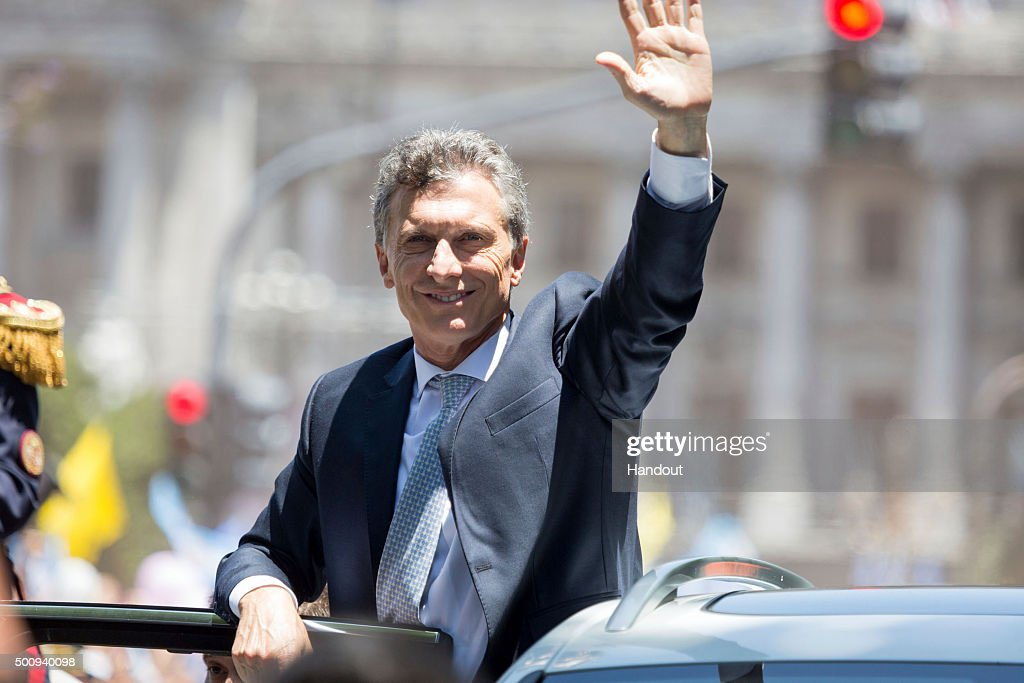 In this handout picture President of Argentina <a gi-track='captionPersonalityLinkClicked' href=/galleries/search?phrase=Mauricio+Macri&family=editorial&specificpeople=773012 ng-click='$event.stopPropagation()'>Mauricio Macri</a> greets the crowd as they head to Casa Rosada after the swearing in ceremony on December 10, 2015 in Buenos Aires, Argentina.