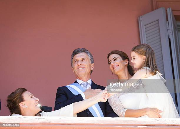 In this handout picture President of Argentina Mauricio Macri his wife Juliana Awada their daughter Antonia and Vice President Gabriela Michetti...