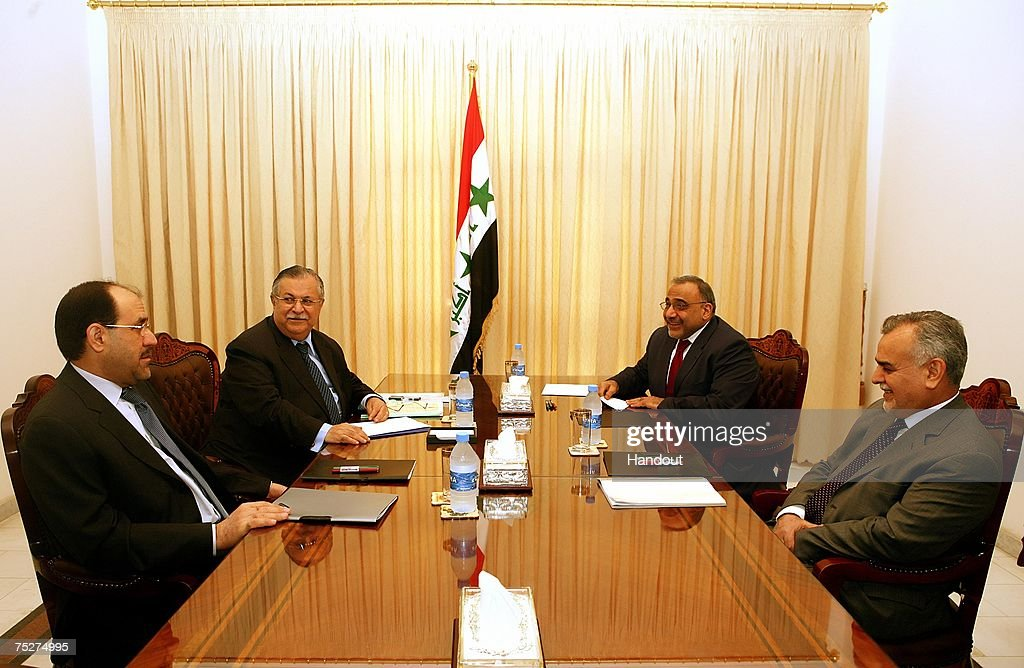 In this handout picture provided by the Iraqi Presidents office, Iraqi Prime Minister <a gi-track='captionPersonalityLinkClicked' href=/galleries/search?phrase=Nouri+al-Maliki&family=editorial&specificpeople=539622 ng-click='$event.stopPropagation()'>Nouri al-Maliki</a> (L-R), Iraqi President <a gi-track='captionPersonalityLinkClicked' href=/galleries/search?phrase=Jalal+Talabani&family=editorial&specificpeople=213582 ng-click='$event.stopPropagation()'>Jalal Talabani</a>, Iraqi Shiite Vice President Adil Abdul-Mahdi, and Iraqi Sunni Vice President <a gi-track='captionPersonalityLinkClicked' href=/galleries/search?phrase=Tariq+al-Hashimi&family=editorial&specificpeople=583300 ng-click='$event.stopPropagation()'>Tariq al-Hashimi</a> meet on July 8, 2007 in Baghdad, Iraq.