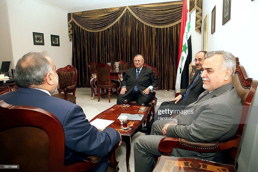 In this handout picture provided by the Iraqi Presidents office, (2nd-L-R) Iraqi President <a gi-track='captionPersonalityLinkClicked' href=/galleries/search?phrase=Jalal+Talabani&family=editorial&specificpeople=213582 ng-click='$event.stopPropagation()'>Jalal Talabani</a>, Iraqi Prime Minister <a gi-track='captionPersonalityLinkClicked' href=/galleries/search?phrase=Nouri+al-Maliki&family=editorial&specificpeople=539622 ng-click='$event.stopPropagation()'>Nouri al-Maliki</a>, Iraqi Sunni Vice President <a gi-track='captionPersonalityLinkClicked' href=/galleries/search?phrase=Tariq+al-Hashimi&family=editorial&specificpeople=583300 ng-click='$event.stopPropagation()'>Tariq al-Hashimi</a> and Iraqi Shiite Vice President Adil Abdul-Mahdi meet on July 8, 2007 in Baghdad, Iraq.