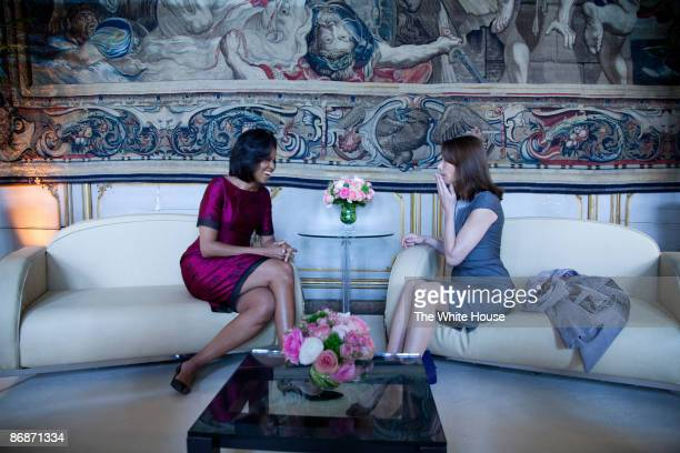 In this handout provide by the White House US First Lady Michelle Obama meets with the First Lady of France Carla BruniSarkozy at the Palais Rohan on...