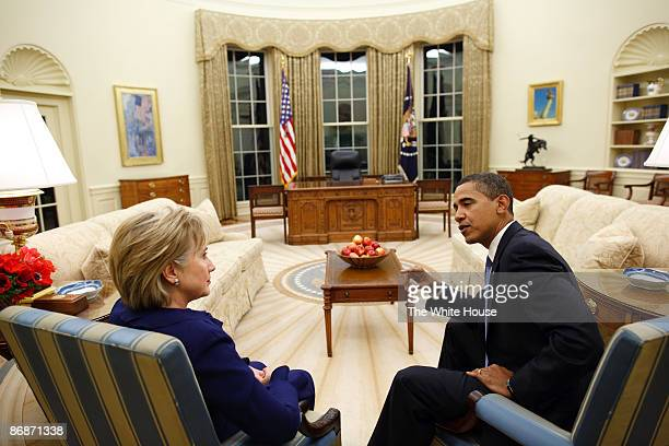 In this handout provide by the White House US President Barack Obama talks with Secretary of State Hillary Rodham Clinton shortly after she was...